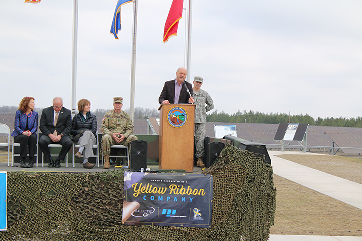 ALLETE Chairman, President and CEO Al Hodnik addresses the crowd at Thursday's ribbon-cutting ceremony for the solar array at Camp Ripley. Looking on (from left) are state Sen. Carrie Ruud, U.S. Rep. Tim Walz, Lt. Gov. Tina Smith, Maj. Gen. Richard Nash and Lt. Col. Sol Sukut